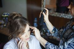 Stylist makeup girl on wedding day Stock Images