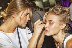 Stylist makeup modeling at photofurum trade show and exhibition. Moscow, Russian Federation - April 22, 2017: Stylist makeup modeling at photofurum trade show Stock Images