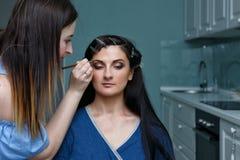 Stylist making make-up girl. Stock Photos