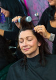 Stylist making woman new hairstyle Royalty Free Stock Image