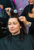 Stylist making woman new hairstyle Stock Photos