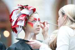 Stylist and model on show for creative makeup Stock Photo