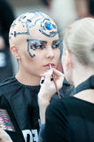 Stylist and model on show for creative makeup Stock Image