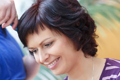 Stylist prepares hairstyle for beautiful woman Royalty Free Stock Photos