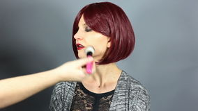 Stylist Putting Make Up on Fashion Model stock video