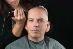 Stylist Shaves Mans Head Stock Image