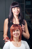 Stylist work on happy woman hair in salon Royalty Free Stock Images
