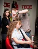 Stylist work on woman hair Royalty Free Stock Photo