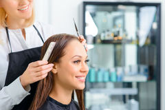 Stylist is working with her client royalty free stock photo