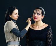 Stylist works with model Stock Photos