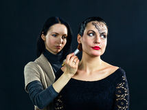 Stylist works with model Royalty Free Stock Images