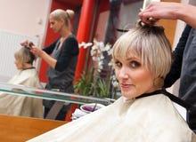 Styliste de cheveu au travail Photo stock
