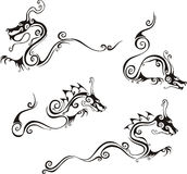 Stylistic dragon tattoos Stock Photos