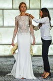 Stylists dress model at runway at RIVINI lookbook shoots during Fall 2015 Bridal Collection Stock Image