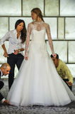 Stylists dress model at runway at RIVINI lookbook shoots during Fall 2015 Bridal Collection Royalty Free Stock Image