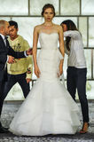 Stylists dress model at runway at RIVINI lookbook shoots during Fall 2015 Bridal Collection Royalty Free Stock Photo