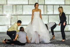 Stylists dress model at runway at RIVINI lookbook shoots during Fall 2015 Bridal Collection Royalty Free Stock Photos