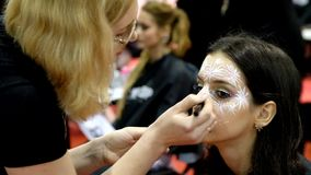 Stylists participate in the wedding makeup competition stock video footage