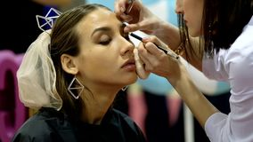Stylists participate in the wedding makeup competition stock footage
