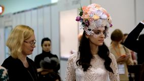 Stylists participate in the wedding makeup competition stock video