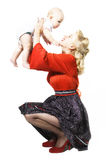Stylization of happy pin-up girl with baby Stock Image