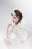 Stylization. Woman with Eggshells and Art Fancy Makeup. Fantasy Royalty Free Stock Images