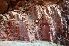 Stylized aboriginal paintings on the pock face Royalty Free Stock Photos