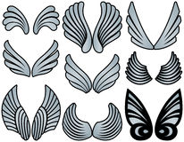 Stylized Angel Wings. Nine Sets of Silver Filled Stylized Angel Wings Royalty Free Stock Photo