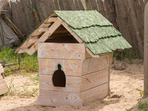 Stylized antique doghouse. A stylized box for the dog on a background wooden fence Royalty Free Stock Photo