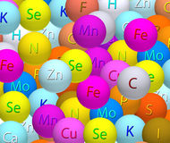 Stylized balls with vitamins closeup Royalty Free Stock Images
