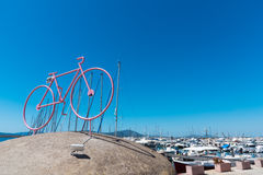 Stylized bike with boats in the background Stock Photo