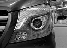 Closeup of chromed headlight. Stylized black and white photo shows a modern new chromed headlamp Royalty Free Stock Photo