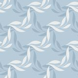 The stylized branch on a blue background. Seamless pattern Stock Image