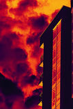 Stylized building with fire smoke Royalty Free Stock Photography