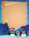 Stylized Christmas penguins parchment 1 Royalty Free Stock Photos