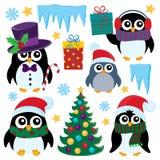Stylized Christmas penguins set 1 vector illustration