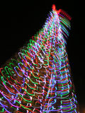 Stylized Christmas Tree. On a Christmas tree of colorful balls thousands of bright and garlands Stock Photo