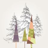 Stylized Christmas trees. Over pine forest background Stock Photography
