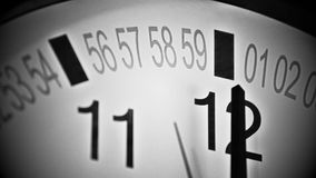 Stylized Clock reaching end of an hour. Noir style wall clock. stock video
