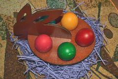 Stylized colored eggs the Easter bunny for Easter. Most commonly spread Christian Easter egg painting is red , whose presence is mandatory Passover meal stock images