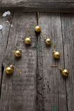 Stylized design Christmas tree with xmas balls on wooden background Stock Images