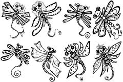 Stylized dragonflies - unique drawings and sketches Royalty Free Stock Images