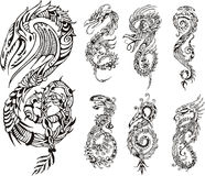 Stylized dragons as initial S. Set of black and white vector illustrations Royalty Free Stock Photos