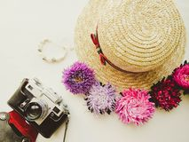 Stylized feminine flatlay with camera, hat, bunch of aster, bracelet mock up isolated on white top view. Woman accessories from. Above. Group Objects stock image