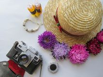 Stylized feminine flatlay with camera, hat, bunch of aster, bracelet mock up isolated on white top view. Woman accessories from. Above. Group Objects stock photo