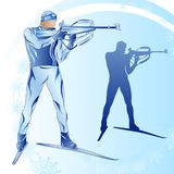 Stylized figure of a biathlonist on a blue background Royalty Free Stock Photos