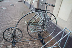 Stylized forged bicycle for parking Stock Images