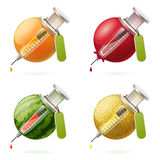 Stylized fruits and syringes Royalty Free Stock Images
