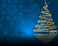 Stylized  golden Christmas tree on mandala background Royalty Free Stock Image