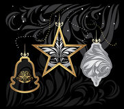 Stylized golden and silver Christmas toys on decorative black background Stock Photography